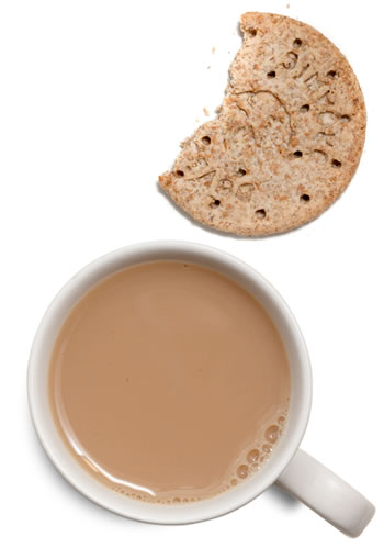 an image of a nice cup of tea and a biscuit